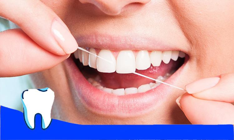 کشیدن نخ دندان